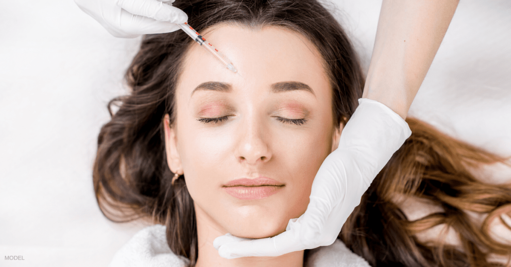 A woman enjoying a painless filler treatment thanks to Pro-Nox